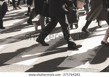 Busy city, people on zebra crossing street,vintage filter. - stock photo
