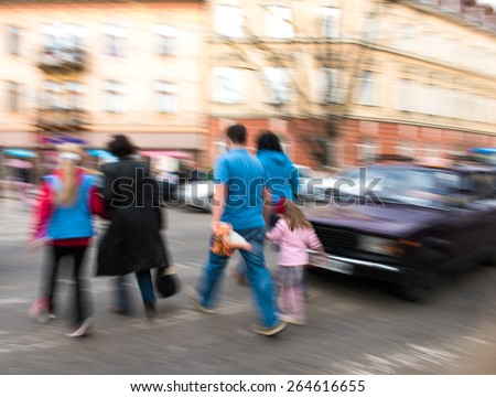 Busy city street people on zebra crossing. Intentional motion blur