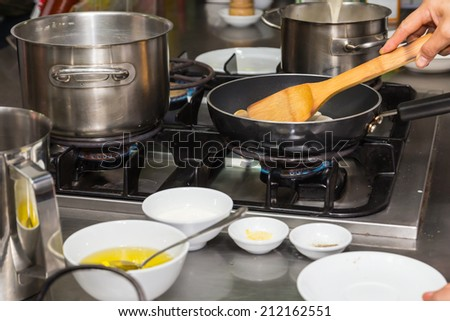 Busy cooking of chefs in restaurant kitchen - stock photo