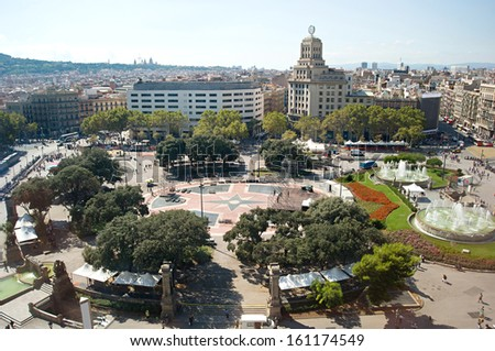 Busy day on Central Square in Barcelona, crowds of tourists in the midday - stock photo