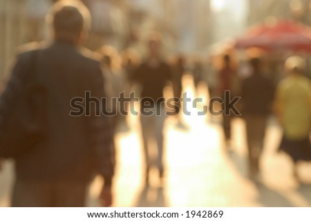 Busy european street. Purposely blurred with a lens. - stock photo