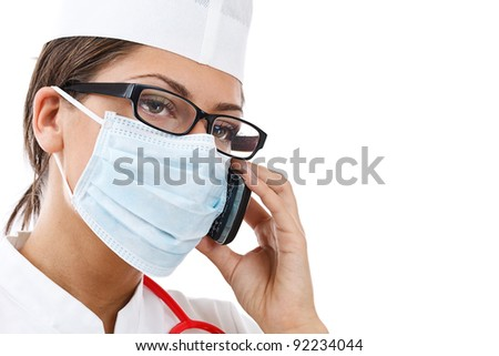 busy female doctor in uniform talking on the phone (isolated on white background) - stock photo