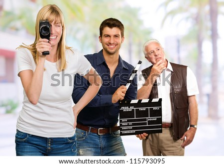 Busy Film Team, Outdoors - stock photo