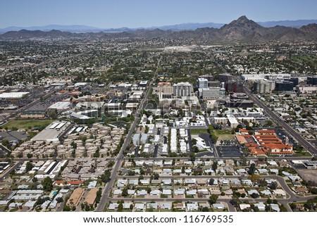 Busy financial district below Piestewa Peak in sunny Phoenix, Arizona - stock photo