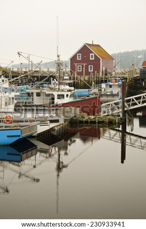 Busy Fishing Wharf in Yarmouth, Nova Scotia, Canada - stock photo