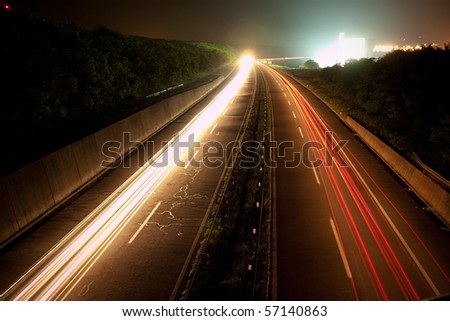 Busy freeway at night - stock photo