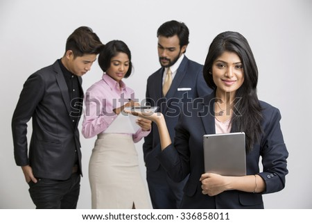 Busy group of business people with businesswoman leader on foreground.