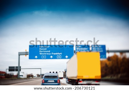 Busy highway autobahn road traffic in Germany - Tilt shift lens used to accent motorway and to emphasize the speed vision - stock photo
