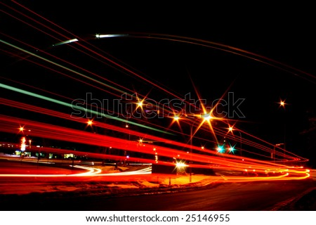 Busy intersection at night.