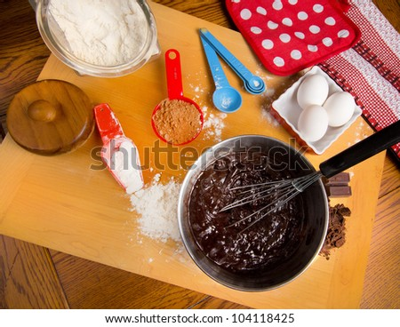 Busy kitchen making brownies with assorted ingredients - stock photo