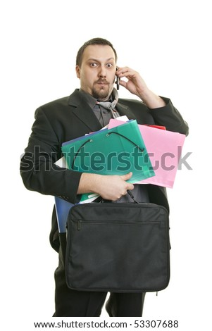 busy man holding a bunch of folder and talk on the phone - stock photo