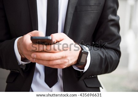 Busy man holding cell phone
