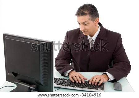 Busy man operating at his desk - stock photo