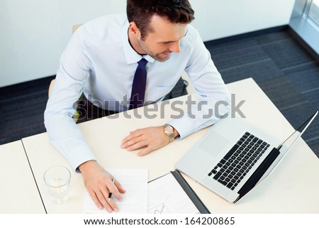 Busy man working in the office. High angle view. Business concept - stock photo