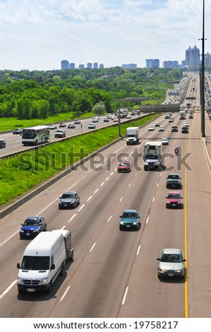 Busy multi-lane highway in a big city - stock photo