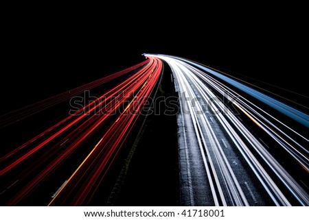 Busy Night Traffic Motion Blur - stock photo