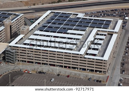 Busy Parking Garages and Highway - stock photo