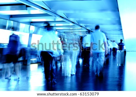 busy people in blurred motion on footbridge - stock photo