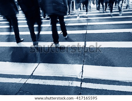 Busy people on zebra crossing street in Hong Kong, China. - stock photo