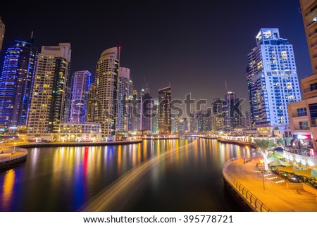 Busy promenade and the bay in Dubai Marina in the evening,Dubai,United Arab Emirates
