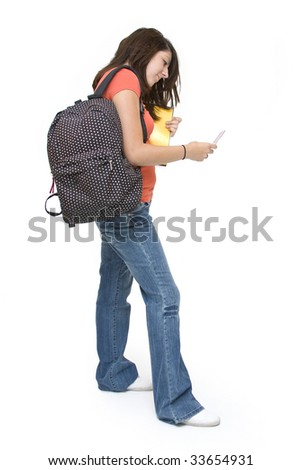 Busy teenage girl student - stock photo