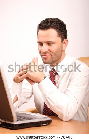 Busy thinking man with laptop having problem