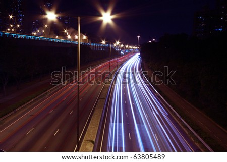 Busy traffic with many cars in highway of Hong Kong - stock photo