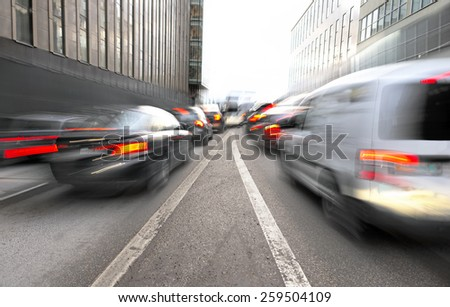 Busy urban traffic with merging lanes in blurred motion - stock photo