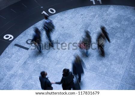 Busy walking - Business people walking along subway - stock photo