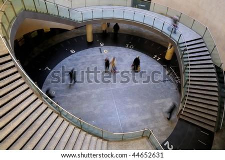 Busy walking - Business people walking along subway in paris - stock photo