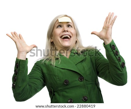 Busy woman over a white background with sticky note on her head and crazy face expression - stock photo