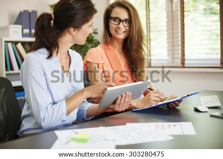 Busy women working in the office - stock photo