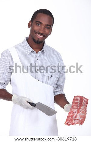 Butcher holding a rack of ribs - stock photo