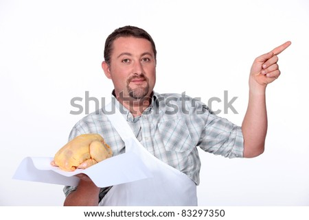 Butcher pointing with a chicken