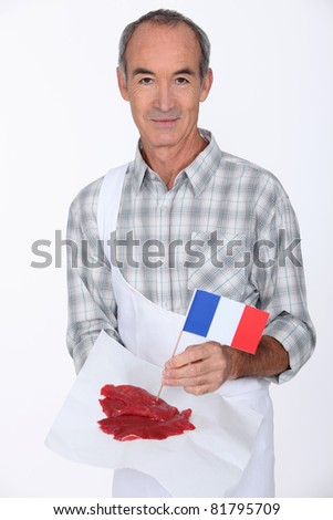 Butcher with French steak - stock photo