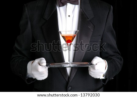 Butler Holding a Cocktail on Silver Tray - stock photo