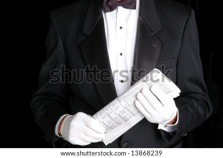 Butler Holding the Folded Business Section of a Newspaper