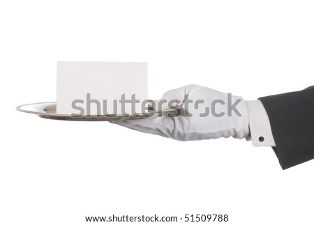 Butler or concierge hand holding silver tray and blank note. Horizontal format arm with hand outstretched from right side isolated on white. - stock photo
