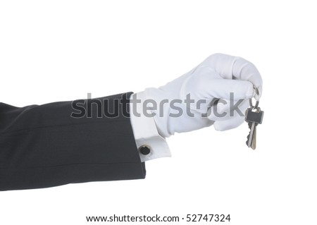 Butler's gloved hand holding two keys on a ring isolated over white. Hand and arm only in horizontal format. - stock photo