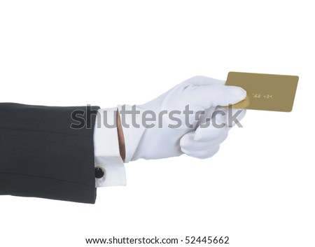 Butler's gloved hand holding up a gold credit card isolated over white. Hand and arm only in horizontal format. - stock photo