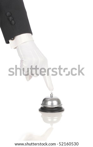 Butler's gloved hand with index finger over service bell isolated on white. Hand and arm only in vertical format with reflections. - stock photo