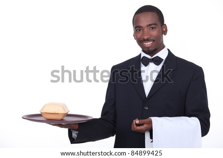 Butler serving a takeout burger - stock photo