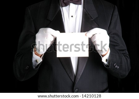 Butler Wearing a Tuxedo and Holding a Blank White Piece of Paper - stock photo
