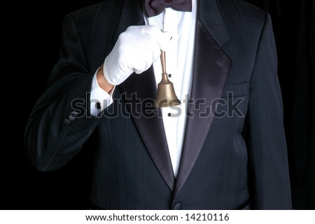 Butler Wearing a Tuxedo and Holding a Service Bell