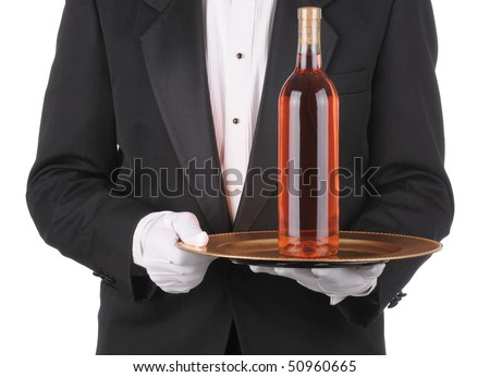 Butler wearing a tuxedo holding a Wine Bottle on Tray. Square Format showing persons torso only. - stock photo