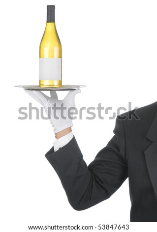 Butler wearing tuxedo and formal gloves holding a white wine bottle on a silver tray. Shoulder hand and arm only isolated on white vertical composition. - stock photo