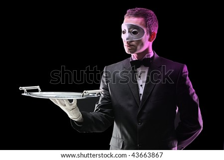 Butler with a face mask holding a tray - stock photo