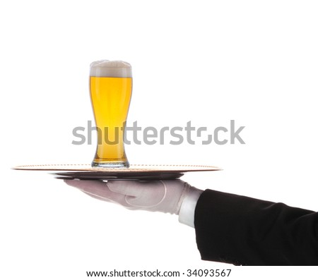 Butler with glass of  beer and tray on outstretched arm isolated over white - stock photo