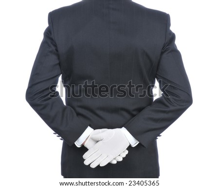 Butler With Hands Behind His Back - torso only isolated on white - stock photo
