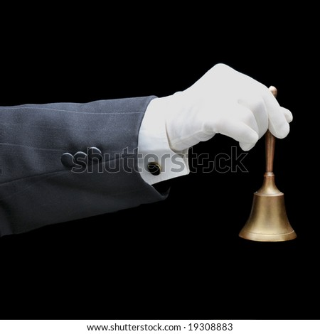 Butlers arm with service bell isolated over black background - stock photo